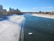 Blocks of ice floating along the partly frozen Bow River