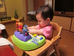 Baby E occupied with new toy