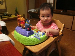 Baby E with new toy