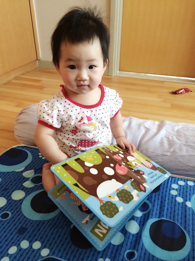 Baby E with right side up book