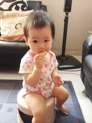 Baby E chomping down cookie
