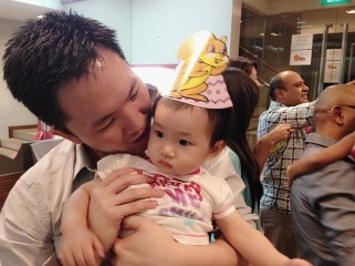 Daddy doting on Baby E