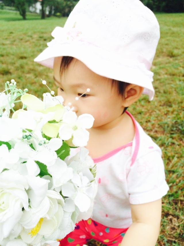 E smelling flowers