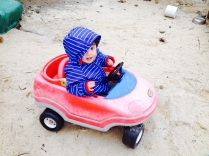 Matthew in a toy car