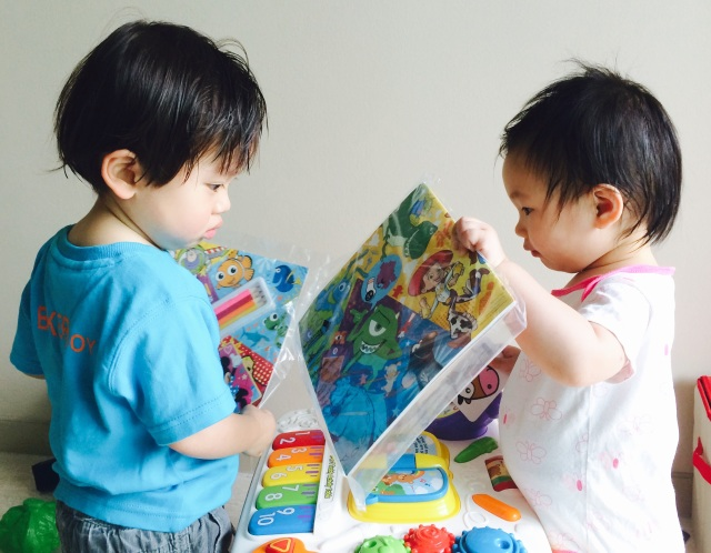 M and E checking out the colouring book