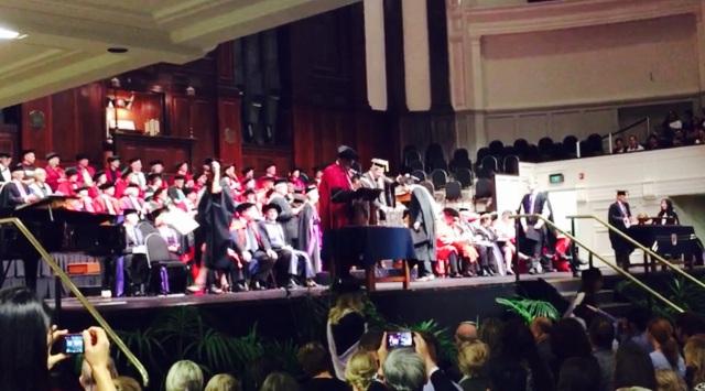 Shen receiving his graduation hat