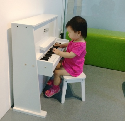 Little E playing piano