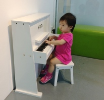 Little E playing piano