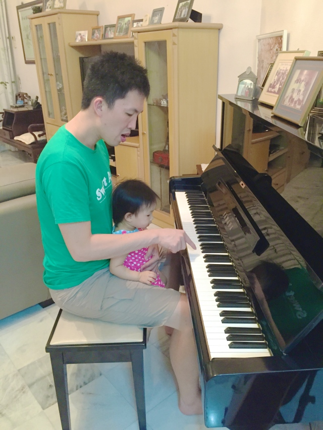 J playing piano with E