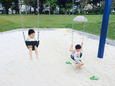 Isaac and Little E on the swing