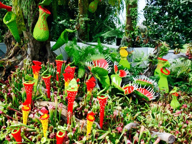 Menacing carnivorous pitcher plants made of Lego blocks.