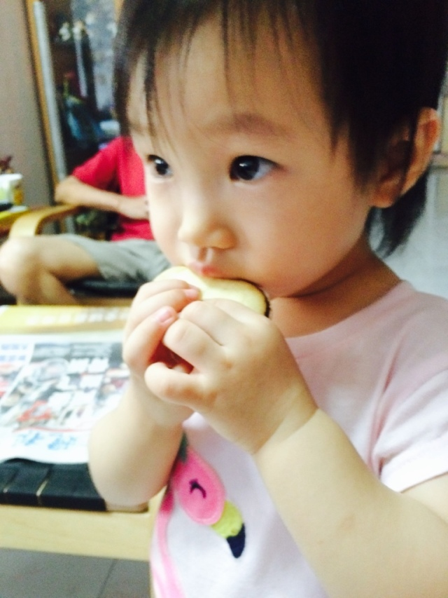 Little E eating Milano cookies given by VA.