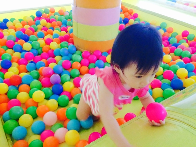 Little E in the ball pit.