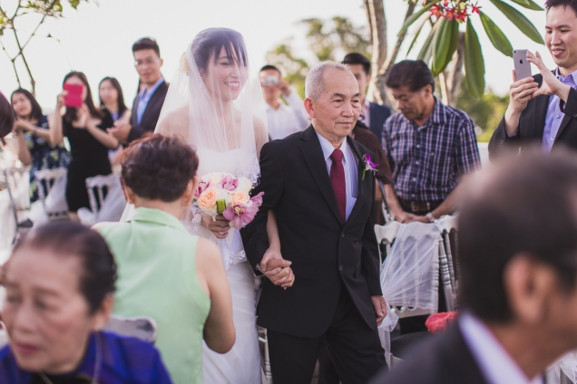 VA walking down the aisle with her father.