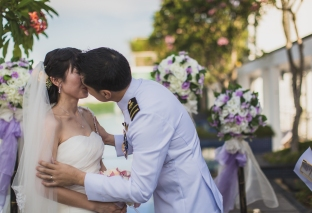 Groom kisses the bride.