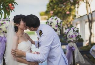 Groom kisses the bride.