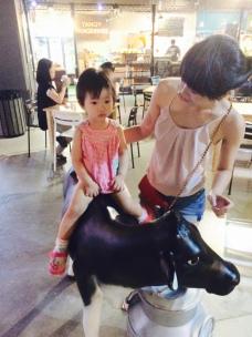 Little E riding the cow!