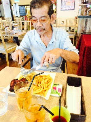 Dad enjoying his chicken steak