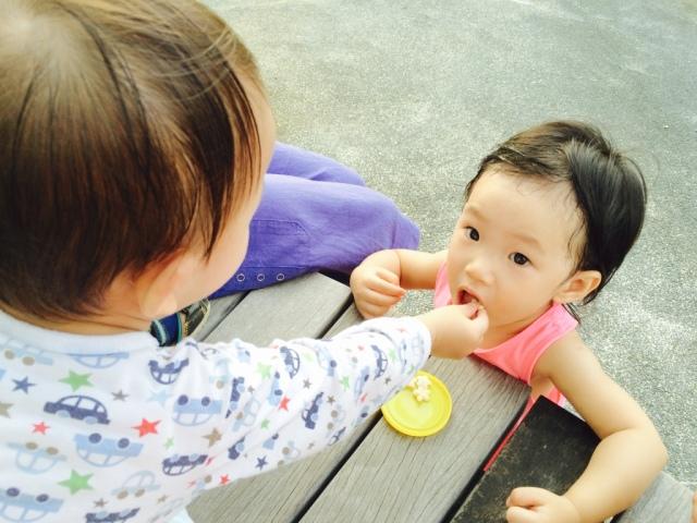 Asher feeding Little E at AMK-Bishan Park