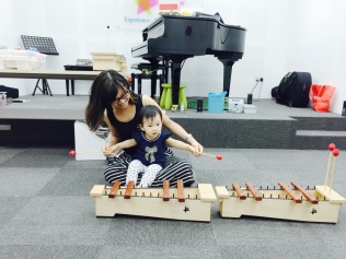 Little E playing the xylophone