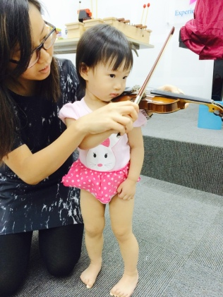 E playing the violin