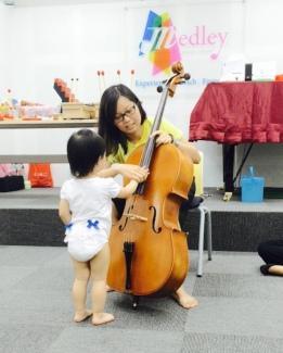 Little E plucking the Cello