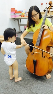 Little E playing the Cello with its bow