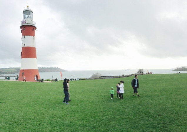 Family with lighthouse in the background