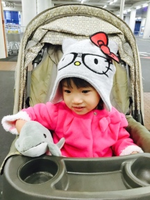 Cutie dressed in Hello Kitty beanie