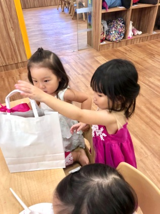 Little H giving out the goodie bags