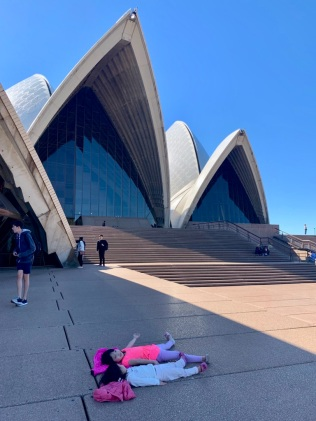 E&H laying down in front of the Opera House