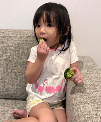 Little H enjoying broccoli 1
